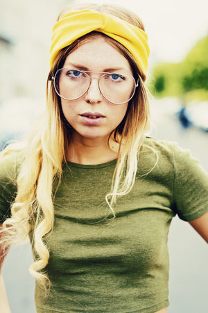 Young women wearing vintage glasses American Authentic Moments EyeEm Best Shots EyeEm Portraits Glasses Green Leipzig Lifestyle Portrait Of A Woman Streets American Apparel Blond Hair College Girl  Expression Eyewear Germany Headpiece Long Hair Look Outdoors Seventies Vintage Women Around The World Yellow Young Women