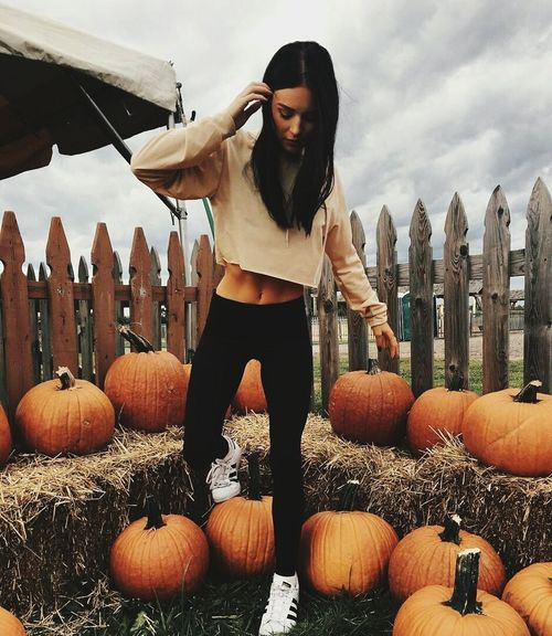 Pumpkin Halloween Only Women One Person One Woman Only Adults Only Front View People Adult Holiday - Event Day One Young Woman Only Standing Full Length Young Adult Smiling Outdoors Portrait Food Young Women
