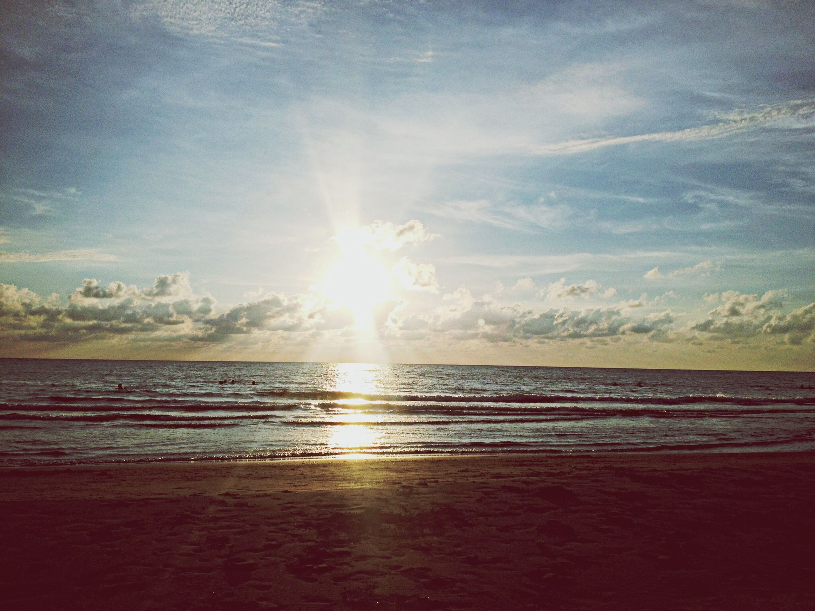 water, sea, beach, scenics, tranquil scene, sun, sky, horizon over water, tranquility, beauty in nature, shore, reflection, sunset, sunlight, nature, idyllic, cloud - sky, sand, sunbeam, outdoors