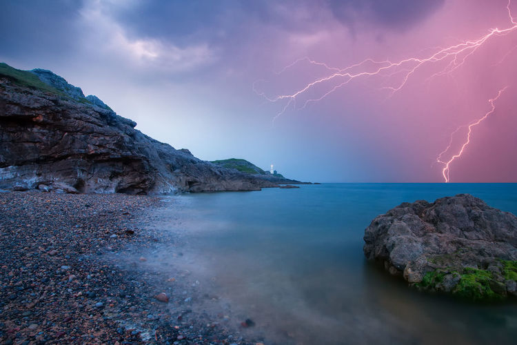 Lightning Awe Beach Beauty In Nature Dramatic Sky Gower Landscape Lighthouse Lightning Mumbles Nature Night No People Outdoors Rock - Object Scenics Sea Storm Cloud