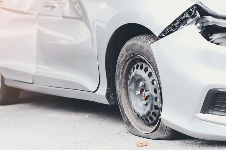 Tire deterioration is the cause of the accident. Car City Close-up Day Land Vehicle Luxury Metal Mode Of Transportation Motor Vehicle No People Outdoors Road Silver Colored Stationary Street Tire Transportation Travel Vehicle Part Wealth Wheel