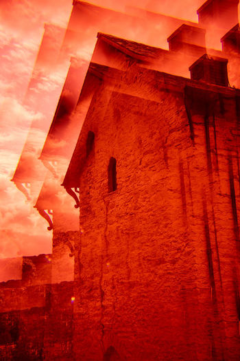 Future Eyes Lens Lomography Prism Prism Art Redscale Red Filter Built Structure Architecture Building Exterior Red Low Angle View No People Building Orange Color Sky Night Sunset Nature Wall - Building Feature Cloud - Sky Outdoors Illuminated Wall Old Religion The Past