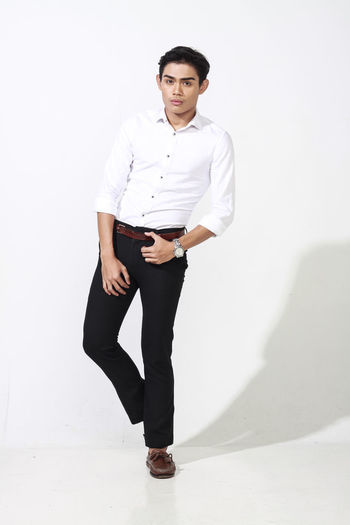 Asian handsome young man wearing fashion lifestyle on white background Casual Clothing Clothing Confidence  Fashion Front View Full Length Fully Unbuttoned Indoors  Leisure Activity Lifestyles Looking At Camera One Person Portrait Real People Standing Wall - Building Feature White Background Young Adult Young Men