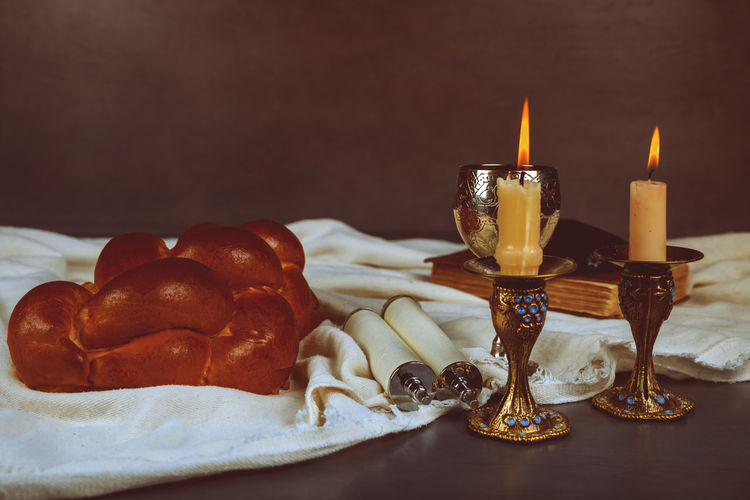 Shabbat Shalom Traditional Jewish Sabbath ritual Homemade freshly baked challah Holy Sabbath Kosher, Shabbat Shabbat Candles Burning Candle Celebration Close-up Fire Fire - Natural Phenomenon Flame Focus On Foreground Food Food And Drink Freshness Glass Heat - Temperature Indoors  Kiddush, Mitzvah, No People Plate Ready-to-eat Shabbat Table Shabbatshalom Still Life Sweet Food Table Temptation