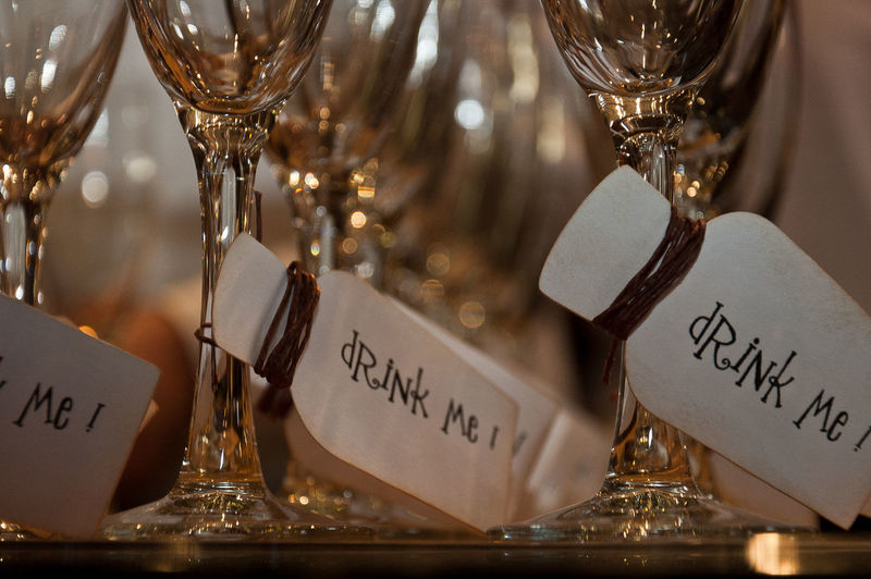 Close-up of label hanging in wineglass