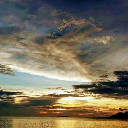 Cloud - Sky Sunset Dramatic Sky Scenics Reflection Outdoors Sea Multi Colored Nature No People Sky Tranquil Scene Water Landscape Beauty In Nature Horizon Over Water Tranquility Beach Day Albay,Philippines Cityscape Travel Destinations Family Fun Vacations