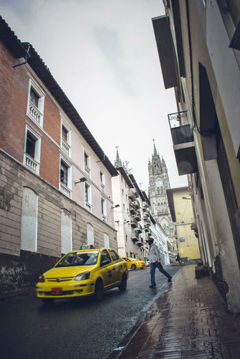 Architecture Building Exterior Built Structure Car City City Life Day Full Length Land Vehicle Men Mode Of Transport One Person Outdoors People Real People Sky Street Transportation Yellow Yellow Taxi