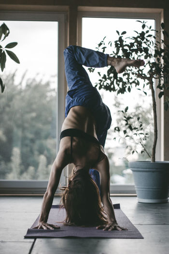 Practice Woman Yoga Yoga Pose Adult Balance Day Exercising Flexibility Full Length Healthy Lifestyle Indoors  Leisure Activity Lifestyles One Person One Woman Only Pilates Real People Relaxation Exercise Skill  Sport Stretching Wellbeing Window Women Yoga Yoga Practice International Women's Day 2019