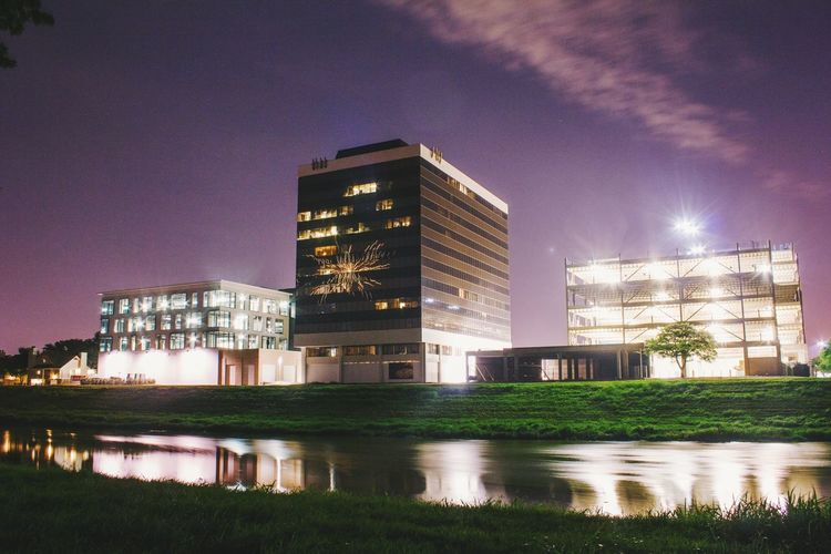 Architecture Building Exterior Building Story Built Structure Canal City City Life Development Financial District  Growth Illuminated Lawn Long Exposure Low Angle View Modern No People Office Building Outdoors Reflection Sky Skyscraper Tall Tall - High Water Waterfront