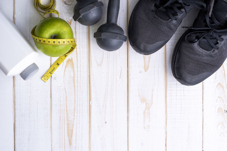 Directly Above Shot Of Fitness Objects On Table
