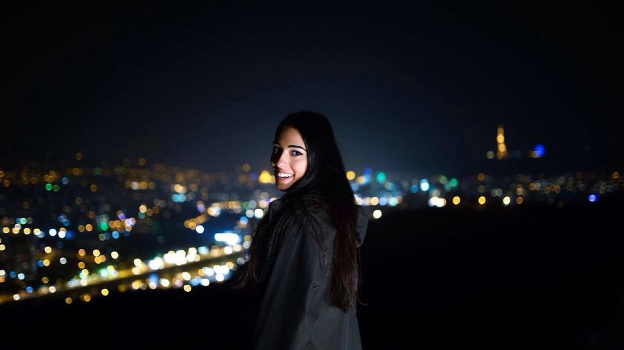 Night One Woman Only Only Women Cityscape City One Young Woman Only Beautiful People Adults Only Beautiful Woman Urban Skyline People Young Adult Standing Adult Illuminated Portrait Beauty Outdoors Women