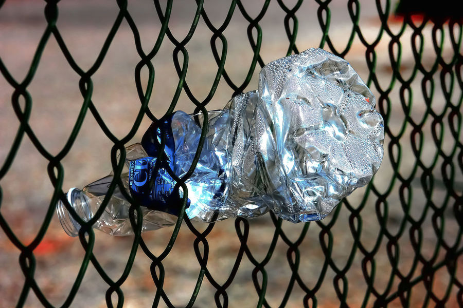 Plastic Environment - LIMEX IMAGINE Barrier Blue Boundary Chainlink Fence Close-up Day Fence Focus On Foreground Jewelry Melting Metal Nature No People Outdoors Pattern Precious Gem Protection Safety Security Shiny Still Life Table