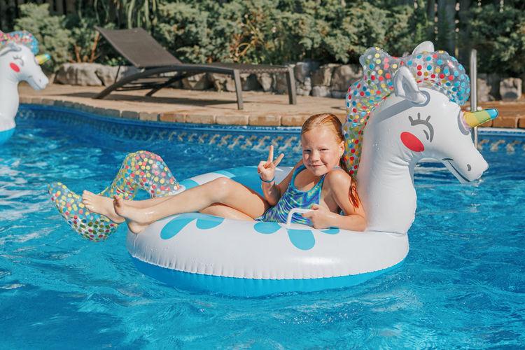 Full length of baby boy in swimming pool