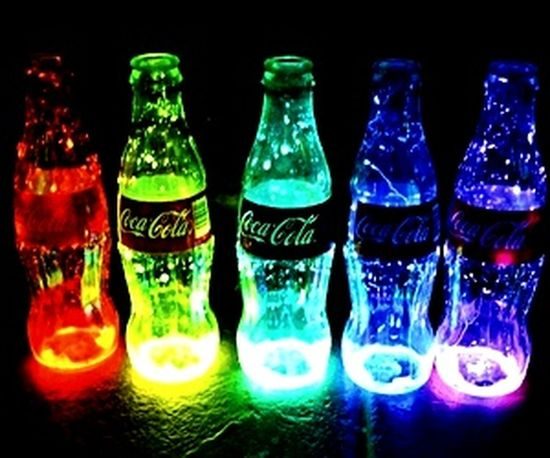 Enjoying neon Coca-Cola bottles All The Neon Lights