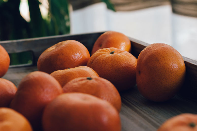 Close-up of orange in serving tray on table