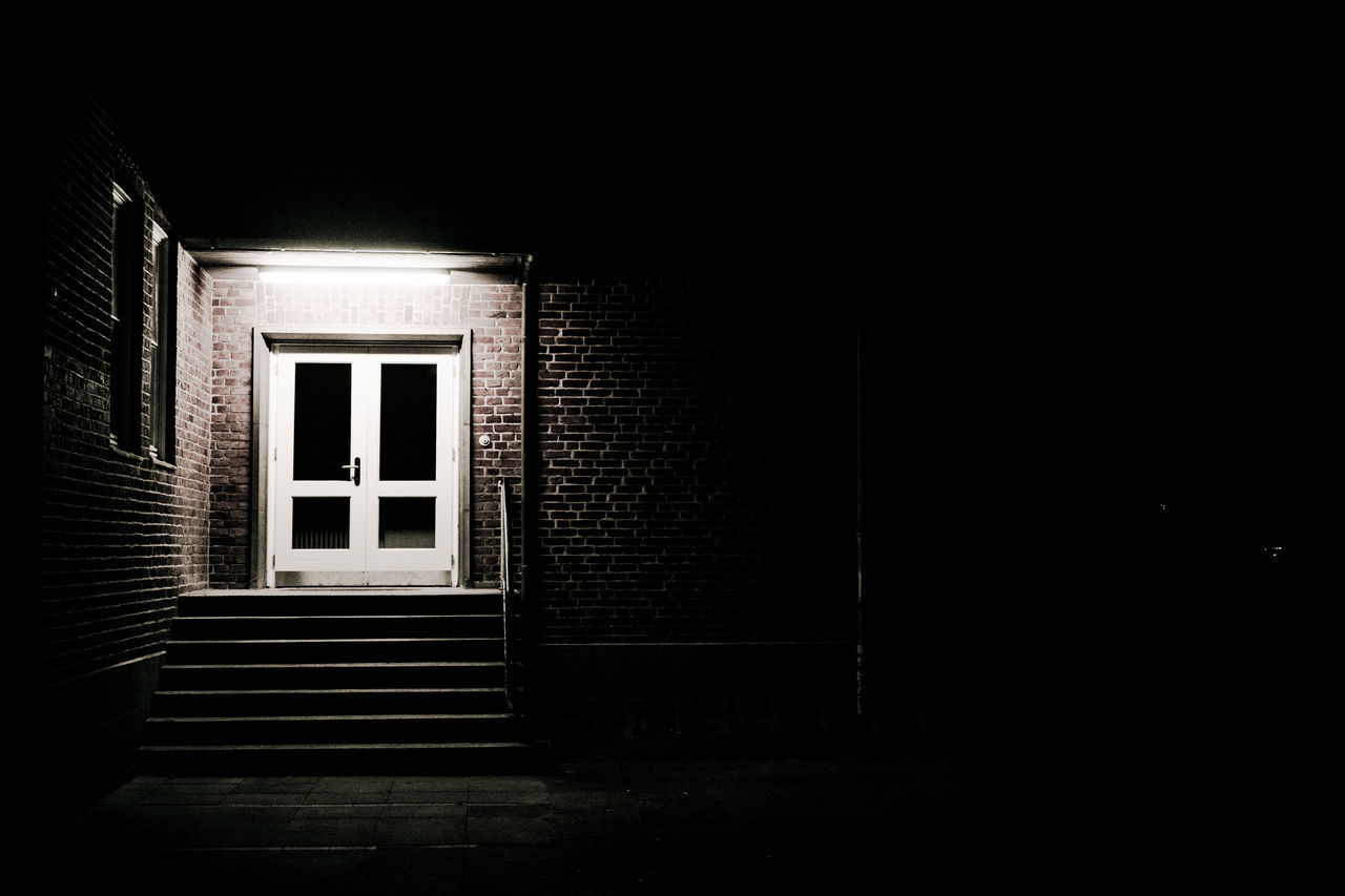 architecture, built structure, dark, night, staircase, entrance, building, door, illuminated, no people, building exterior, copy space, direction, window, closed, brick, wall, outdoors, the way forward