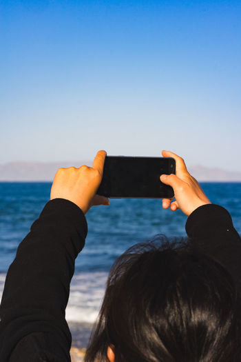 Women take picture of the ocean with mobile phone Mobile Phone Ocean View Vacations App Background App Design Horizon Over Land Sky Take Picture Website Background Women