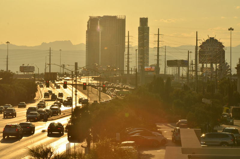 Cars God Rays Silhouette Sunlight Architecture Backlit Building Exterior Built Structure City Day Freeway Highway Land Vehicles No People Outdoors Sunbeams