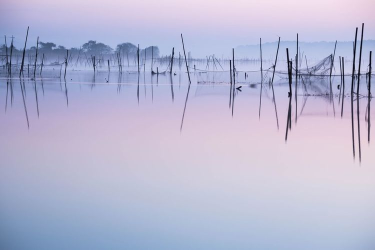 Beautiful view of calm lake with artisanal fishing nets
