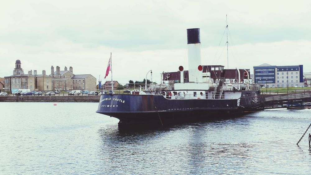 Cloud - Sky Water Nautical Vessel Outdoors Sky Architecture Travel Destinations Harbour View Quayside Harbour Outdoor Photography Historic Mooring Steamboat Paddle Steamer Vessel Vessel In Port Landscape Water_collection Rippled Transportation Mode Of Transport Flag Let's Go. Together.