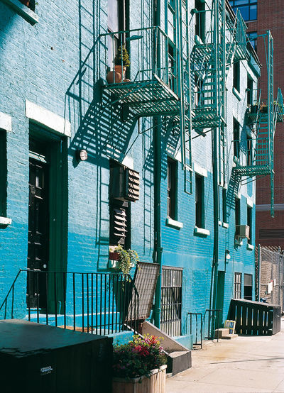 Analogue Photography City Life Housefront New York City Travel Photography USA Architekture Blue Colour Daylight Photography Diascan Fire Escape Ladders No People Outdoors Photography
