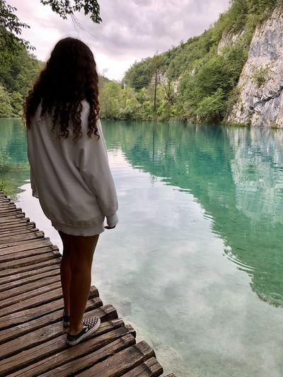 Rear view of girl looking at lake