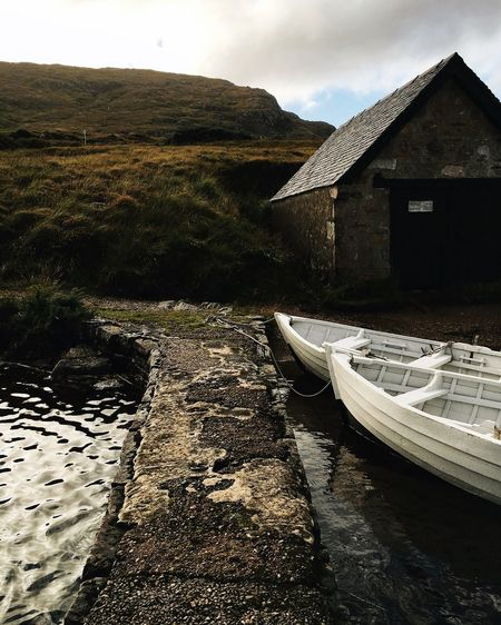 highland light EyeEmNewHere Loch  Scotland The Week On EyeEm Architecture Boat Boats Building Exterior Built Structure Day Moody Moored Mountain Nature Nautical Vessel No People Outdoors Scottish Highlands Sky Tranquility Water
