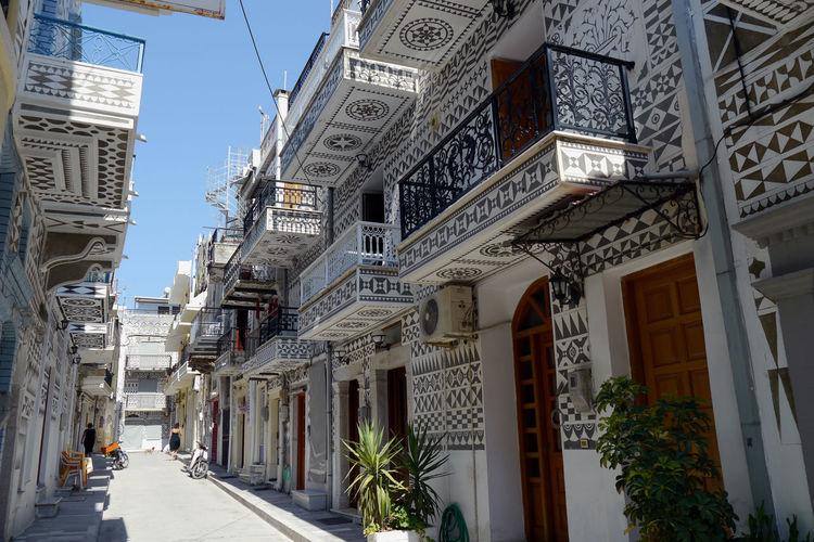 Narrow street amidst buildings