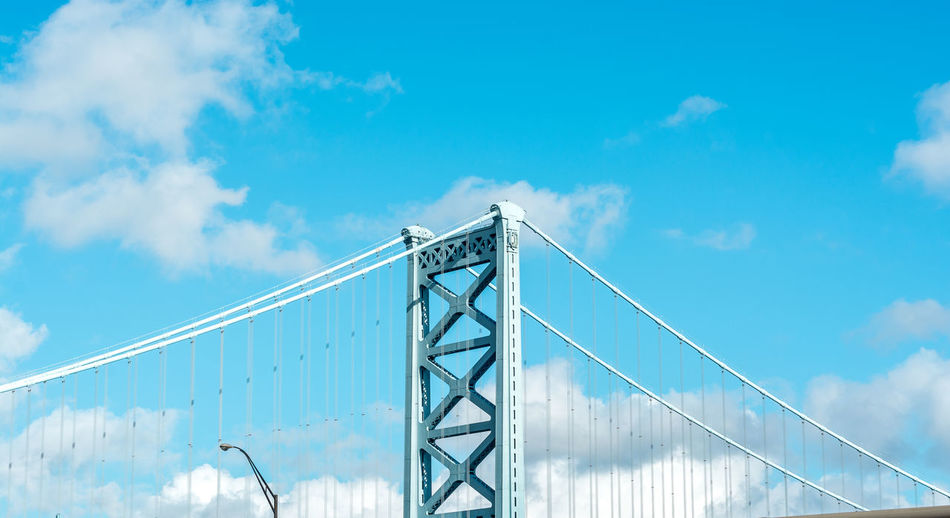 Blue sky with clouds over the bridge Architecture Bridge Bridge - Man Made Structure Built Structure Connection Engineering Long Railing River Structure SUPPORT Suspension Bridge The Way Forward
