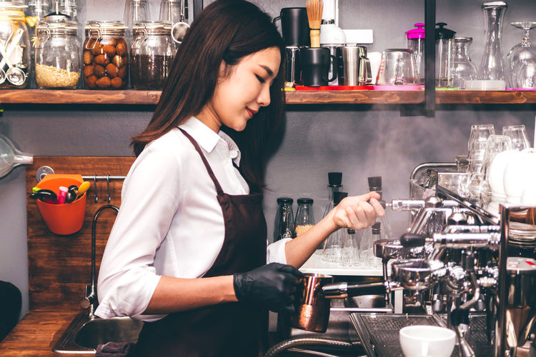 Midsection of woman standing at cafe