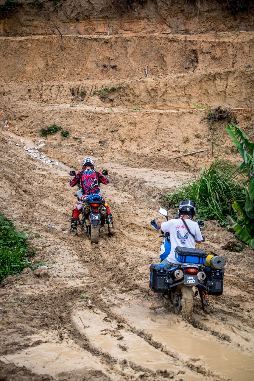 transportation, sitting, riding, mode of transport, adult, motorcycle, outdoors, people, land vehicle, men, day, rural scene, real people, adults only, only men, one man only, mammal