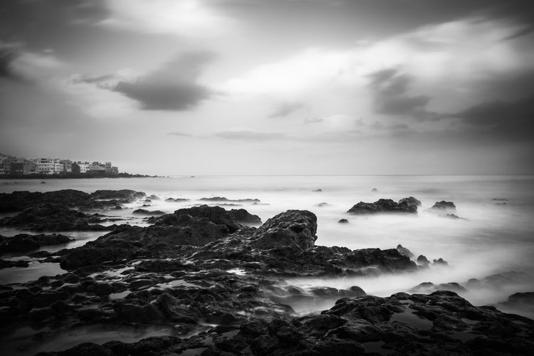 Coastline Sea And Sky Long Exposure Clouds And Sky Rocks Rock Formation Traveling Tranquil Scene Cloudy Early Morning Blackandwhite Black And White Outdoors Travel Fine Art Photography