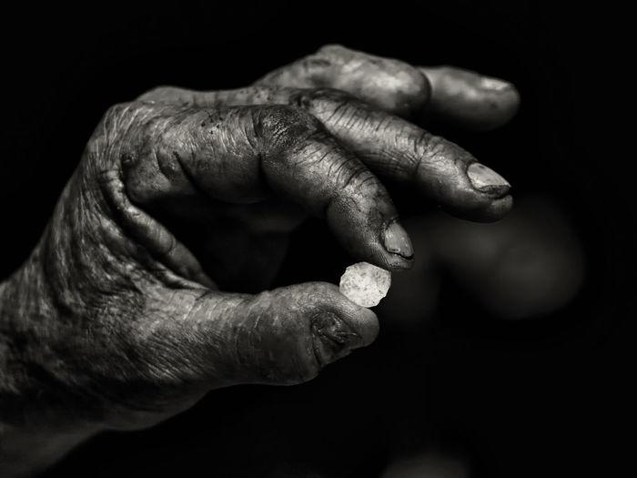 Cropped hand holding diamond