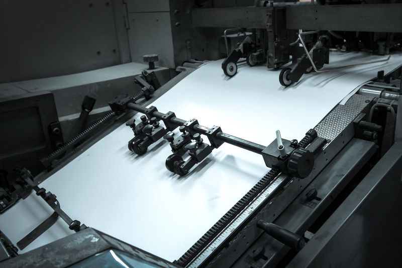 Close-up of blank paper in printing press
