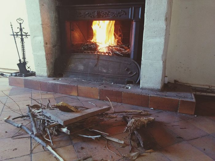 Bonfire on wooden floor in house