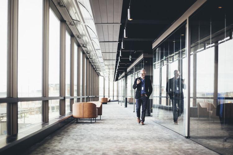 Man standing on corridor of building