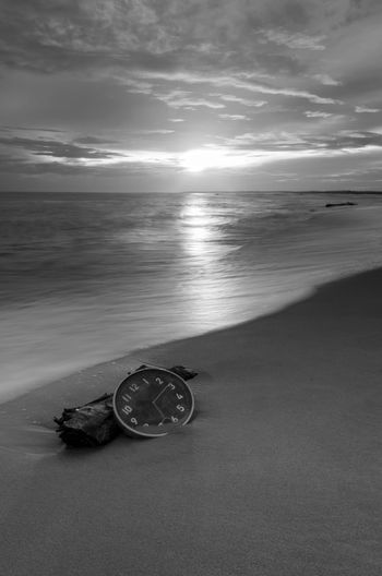 Concept alarm clock on beach of island, malaysia. Fine art black and white. Blackandwhite Fine Art Photography Long Exposure Wallpaper Background Malaysia Concept Wall Clock Sea Water Beach Salt - Mineral Sand Shadow Sunlight Wave Nautical Vessel Sky