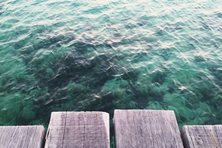 View of pier by water