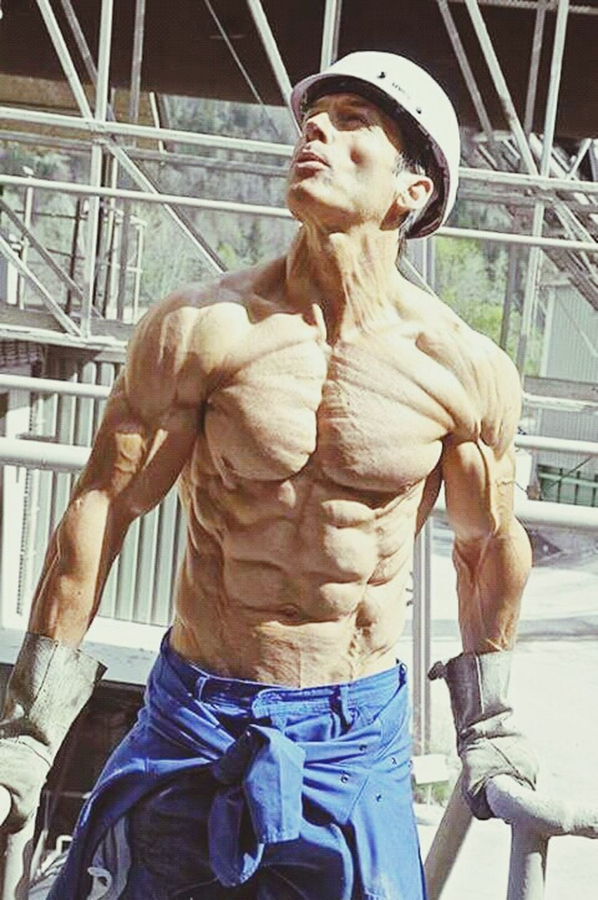 strength, lifestyles, young adult, one person, muscular build, real people, outdoors, day, city, adult, people