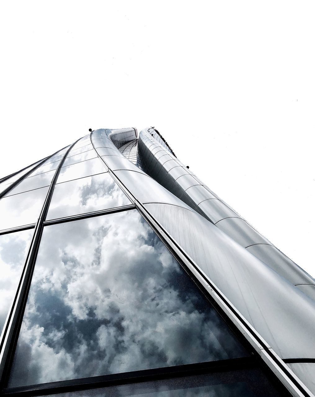 sky, low angle view, built structure, architecture, building exterior, no people, nature, cloud - sky, day, building, outdoors, glass - material, window, metal, copy space, tall - high, office, reflection, city, connection, office building exterior