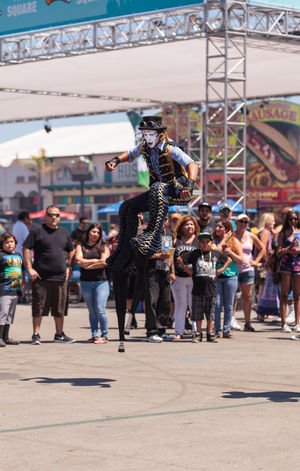 Costa Mesa, CA, USA - July 16, 2016: Dragon Knights steampunk stilt walkers perform at the Orange County Fair in Costa Mesa, CA on July 16, 2016. Editorial use only. Adult Adults Only Amusement Parks Dance Day Dragon Knights Entertainer Fair OC Fair Orange County Fair Outdoors People Performer  Stilts Stiltwalker Young Adult