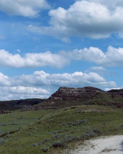 Sky Tranquility Mountain Cloud - Sky Landscape Nature Scenics Tranquil Scene Beauty In Nature Non-urban Scene Geology Day Idyllic Travel Destinations Outdoors Grass No People Remote Physical Geography Mountain Range Saskatchewan