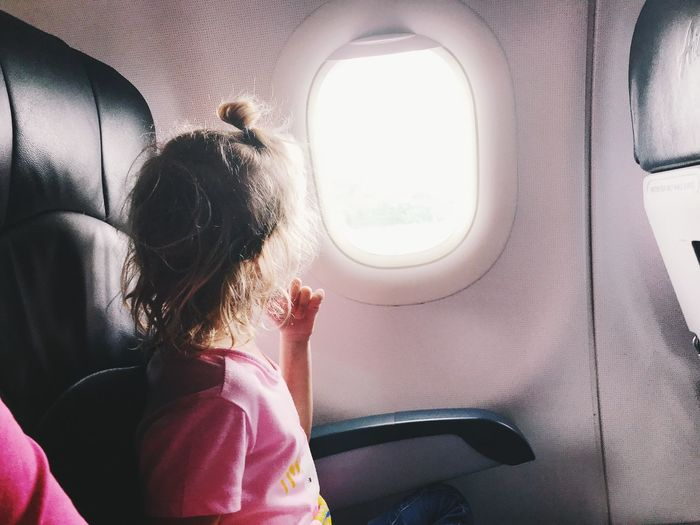 Girl sitting in airplane