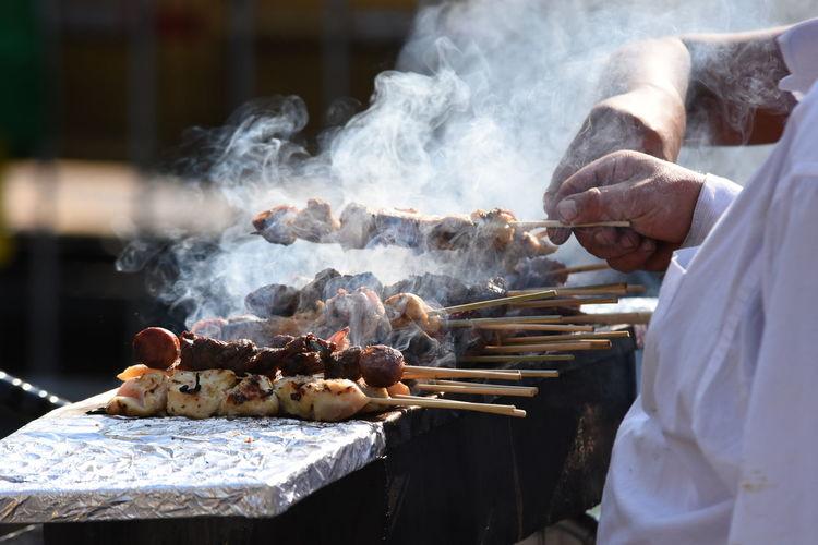 Midsection Of Venders Preparing Street Food