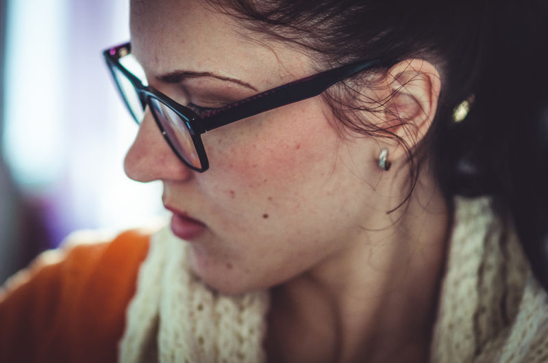 nachdenklich. Adult Close-up Day Earrings Eyeglasses  Face Female Focus On Foreground Indoors  One Person One Young Woman Only People Real People Thinking Thoughts Young Adult Young Women