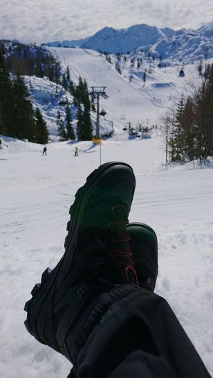 Male boots and crossed legs on mountain ski resort Male Boots Crossed Legs Feet Snow Winter Cold Temperature Human Body Part Mountain Outdoors Travel Destinations Scenics Day One Person Ski Winter Europe Slovenia Vogel Snow ❄ People Leisure Activity Leisure Relaxing Relaxation