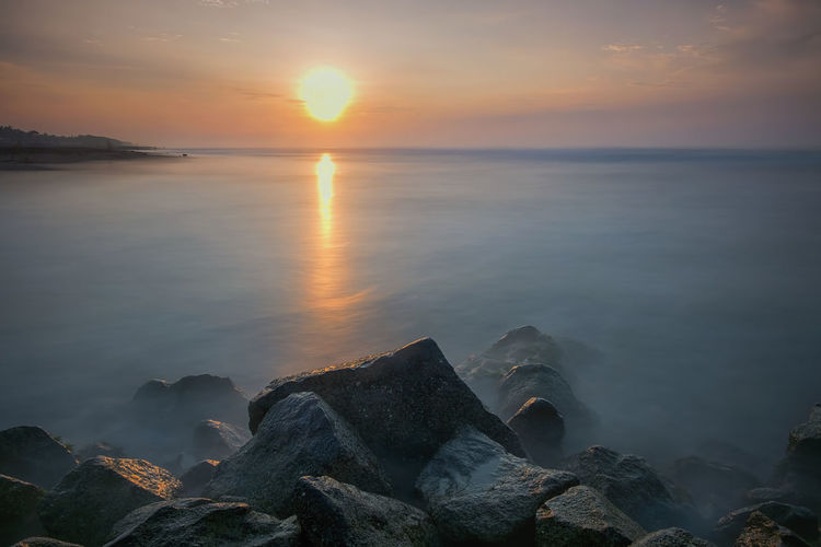 sunrise and rock INDONESIA Beach Beauty In Nature Central Java Cloud - Sky Horizon Horizon Over Water Idyllic Indonesia_photography Nature No People Non-urban Scene Outdoors Rock Rock - Object Scenics - Nature Sea Sky Solid Sun Sunset Tranquil Scene Tranquility Water