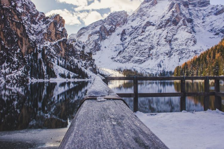 Braies Lake Snow Cold Temperature Mountain Winter Lake Nature Scenics Beauty In Nature Mountain Range Water Non-urban Scene Outdoors Snowcapped Mountain Frozen No People Tranquility Ice Day Landscape Tree first eyeem photo