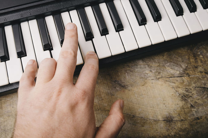 Keyboard synthesizer Black Buttons Close-up Composer Electro Human Body Part Human Hand Instrument Key Keyboard Instrument Leisure Activity Lifestyles Man Music Note Piano Piano Key Player Playing Song Songwriter Synthesizer Technology White Wood - Material