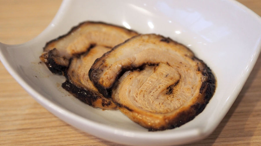 Chashu pork slide 2 pieces for top up on the traditional tonkotsu japanese ramen noodle dish. Japanese Food Chashu Chashu; Pork; Food; Japanese; Soup; Noodle; Ramen; Background; Delicious; Gourmet; Cooking; Healthy; Cuisine; Style; Plate; Dish; Roasted; White; Fresh; Broth; Tonkotsu; Meal; Asian; Tasty; Nutrition; Black; Asia; Vegetable; Eating; Lunch; Restaurant; Fat Close-up Day Food Food And Drink Freshness Indoors  No People Noodle Ramen Ready-to-eat Shashu Top View